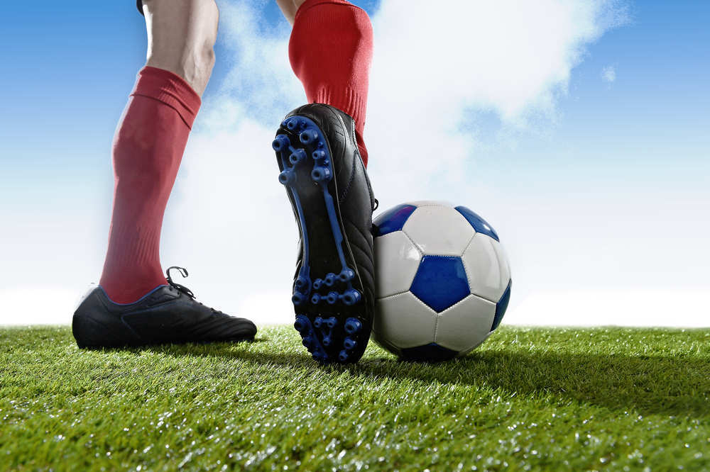Unas botas de fútbol nuevas para mi hijo